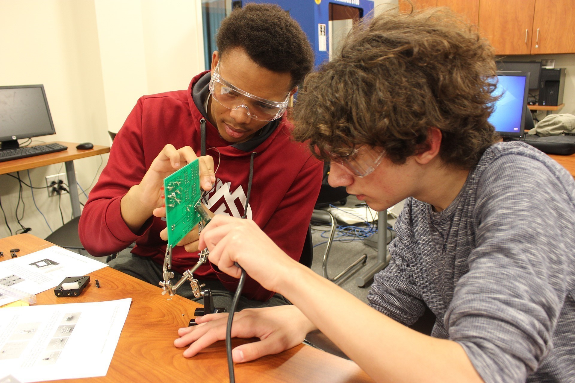 students working with electronics